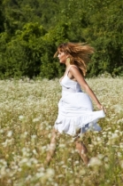 """Young woman walking in meadow"" courtesy of adamr/ FreeDigitalPhotos.net"