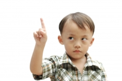 """Young Asian Boy With Hand Sign"" courtesy of arztsamui/ FreeDigitalPhotos.net"