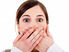 """""Woman Covering Her Mouth With Both Hands"" courtesy of photostock/ FreeDigitalPhotos.net"